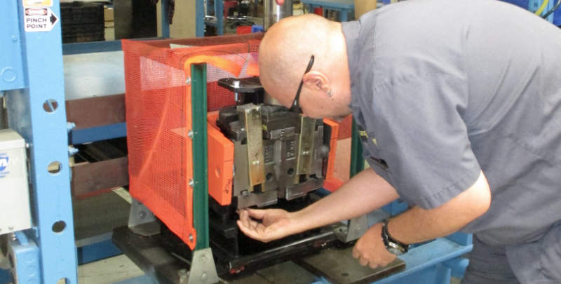 Outsourced Processes - A Whitesell Operator is completing the assembly of a critical elevator safety component.